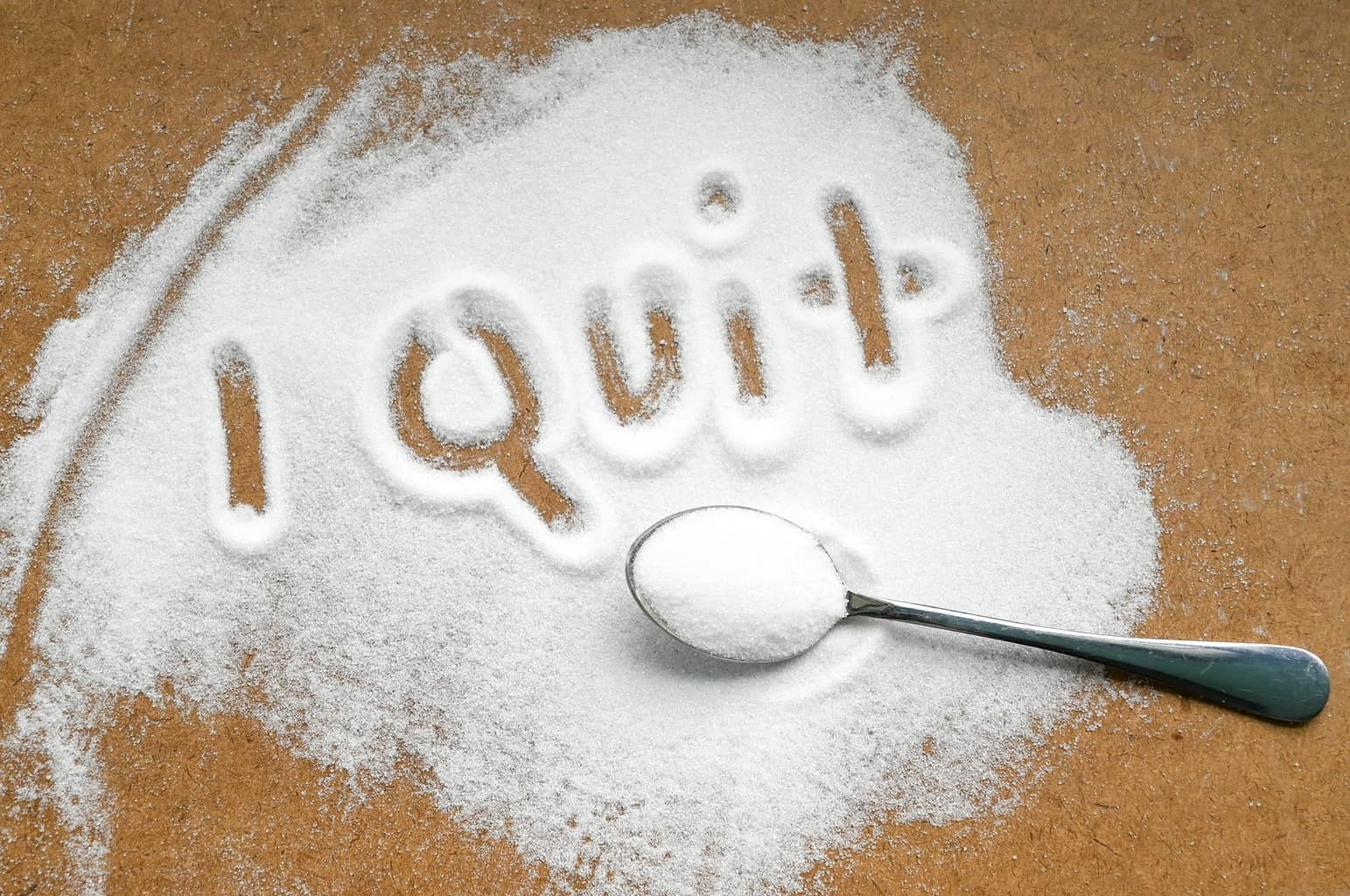 I quit written in sugar denoting the need to quit sugar