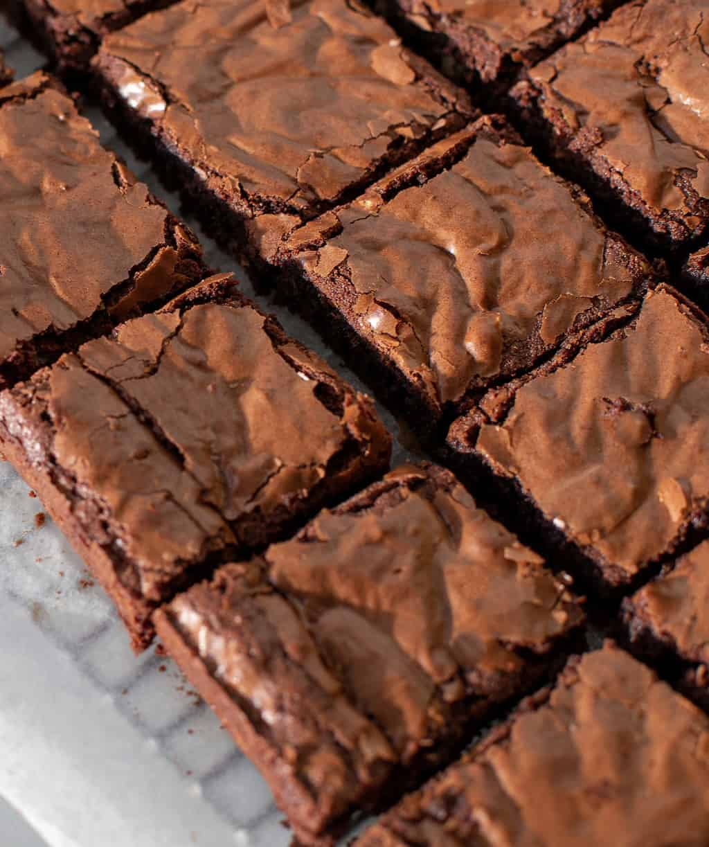 Coconut flour keto brownies on a parchment lined baking rack
