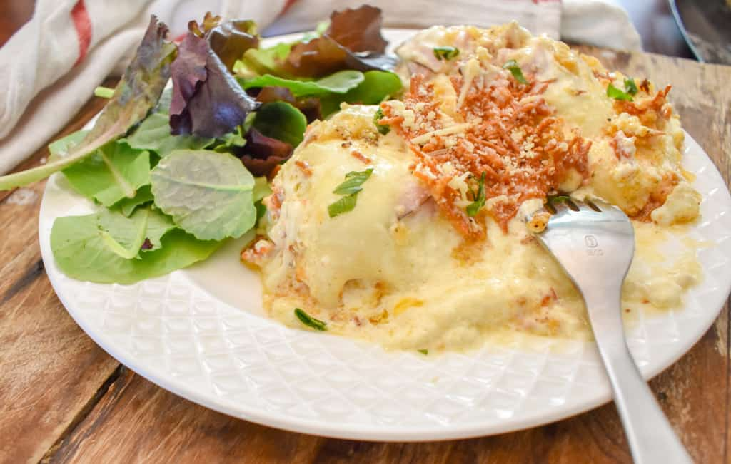 keto chicken cordon bleu casserole served with salad up close