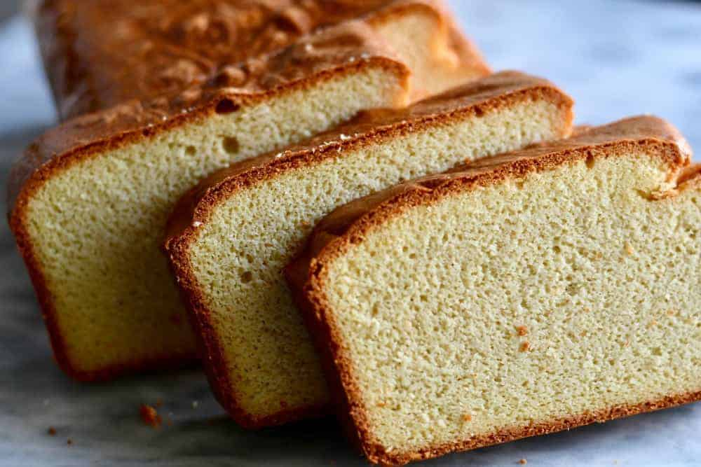 keto quick bread a no fuss low carb bread recipe sliced on a white plate