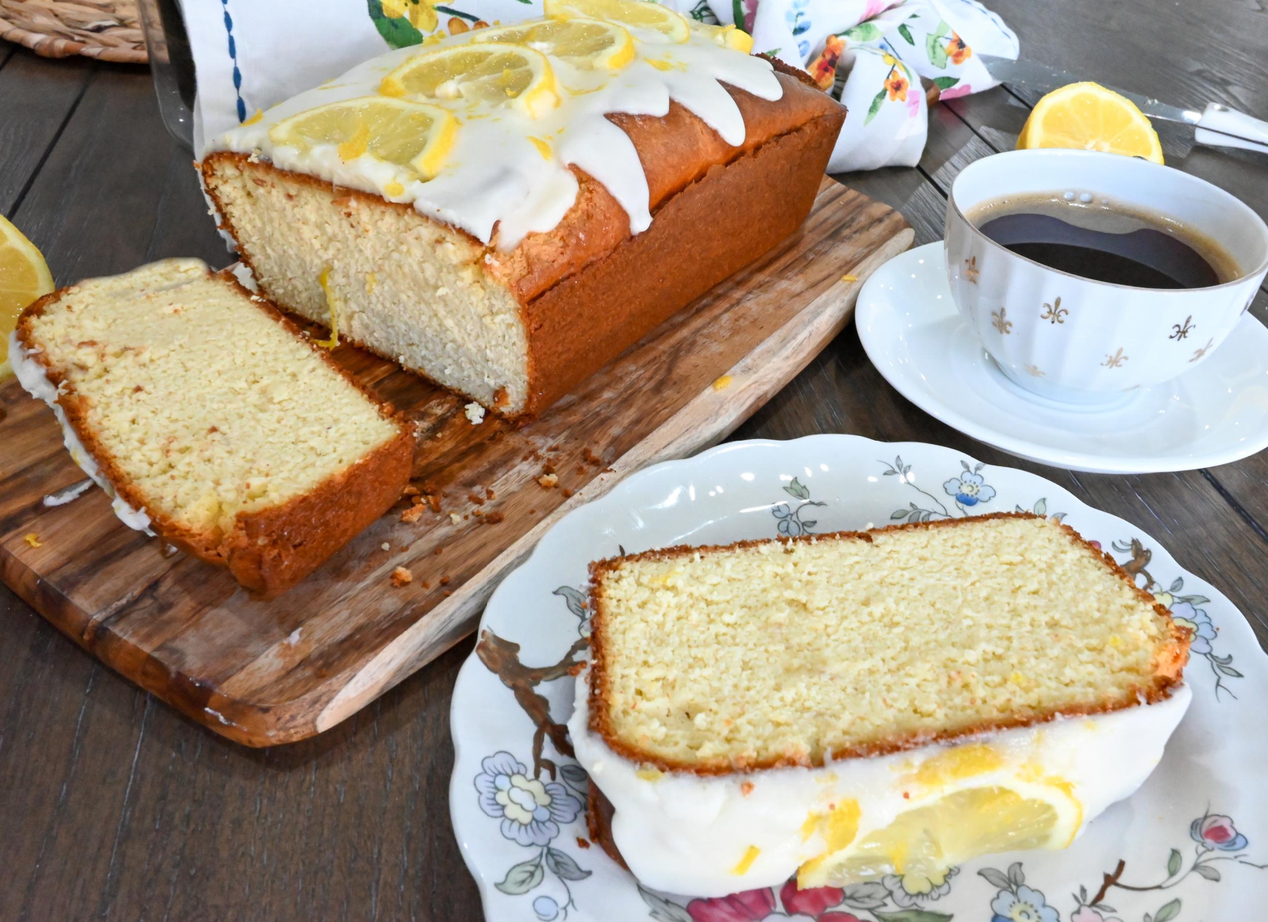 keto lemon pound cake sliced and served on fine china