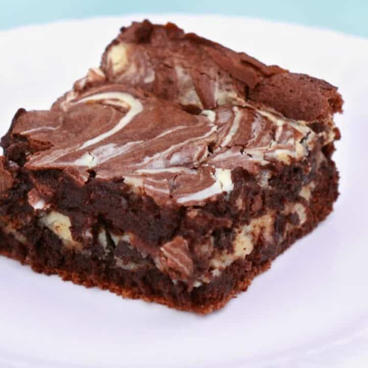 Keto cheesecake swirled brownies to curb your chocolate and cheesecake cravings.