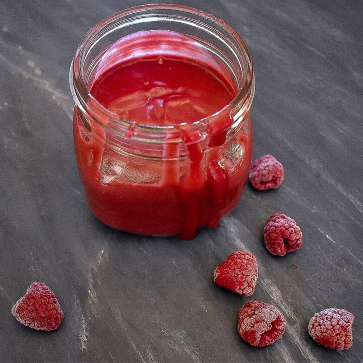 sugar-free raspberry curd in a mason jar