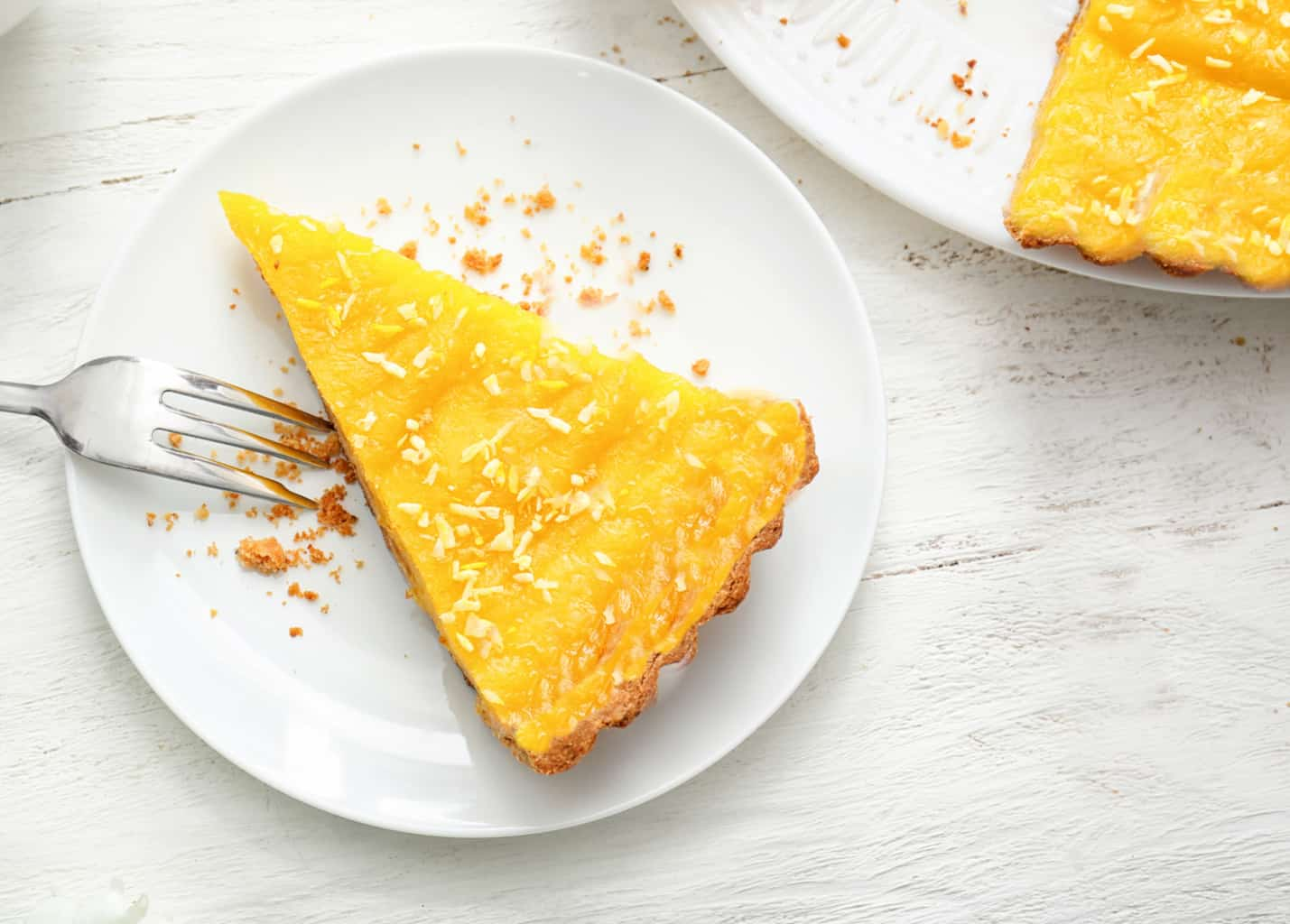 low carb lemon curd pie sliced on white plate