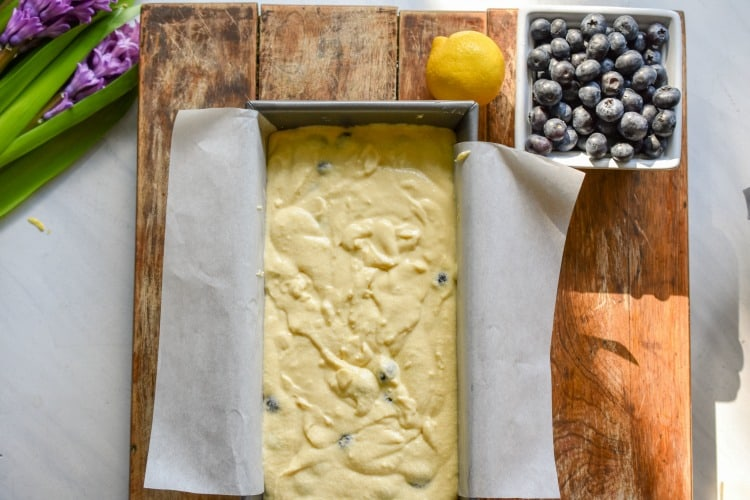 keto blueberry lemon bread batter in a loaf pan