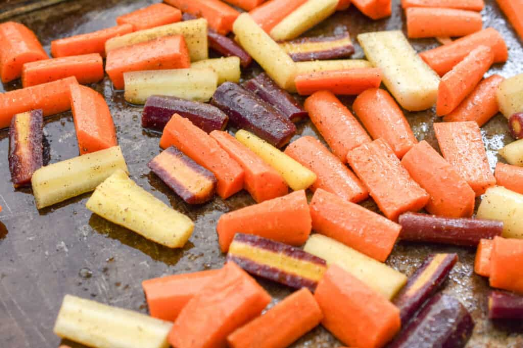 keto carrots being roasted in a baking sheet