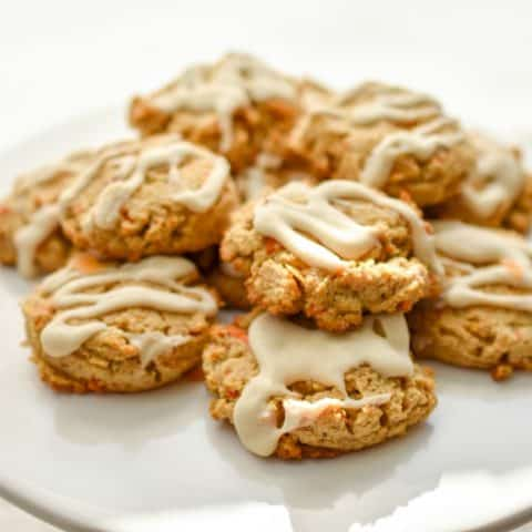 Keto Carrot Cake Cookies-What's great about a healthy version of a carrot cake cookie is that it gives you built-in portion control. These keto-friendly carrot cake cookies are packed with the warm spices of cinnamon, ginger, and nutmeg. And they're texture is spot on. Soft, chewy and everything you love about carrot cake cookies minus the high carbs. #ketocookies #lowcarbcookies #ketocarrotcakecookies