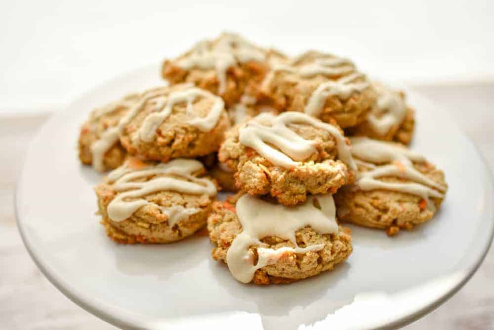 Keto Carrot Cake Cookies-What's great about a healthy version of a carrot cake cookie is that it gives you built-in portion control. These keto-friendly carrot cake cookiesare packed with the warm spices of cinnamon, ginger, and nutmeg.And they're texture is spot on. Soft, chewy and everything you love about carrot cake cookies minus the high carbs. #ketocookies #lowcarbcookies #ketocarrotcakecookies