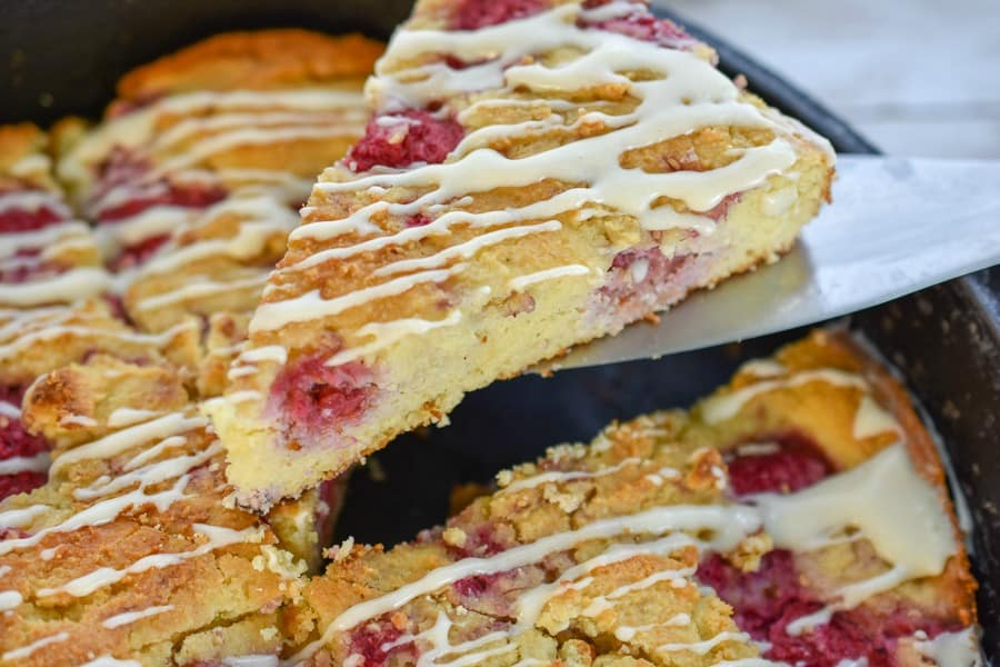 Keto Raspberry Scones-makes the perfect low carb treat. They have all the flavor we love in traditional raspberry scones minus all the carbs. Plus, it's easy because you do not roll out the dough in this recipe. #ketoscones #lowcarbscones #ketoraspberryscones #lowcarbraspberryscones