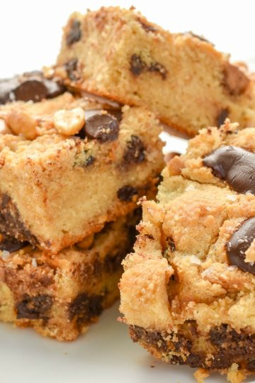 These Keto Peanut Butter Chocolate Chip Bars are loaded with peanut butter and chocolate goodness. Thick and oozing with peanut butter and melty sugar-free chocolate chips makes these the perfect little low carb treat.