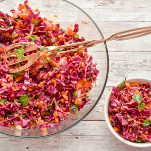 This Keto Red Cabbage And Carrot Slaw recipeisthe perfect spring & summer side dish. It features a tangy apple cider vinaigrette that keeps this slaw light, crunchy, and slightly spicy. It's a refreshing salad that packs a lot of nutrition.