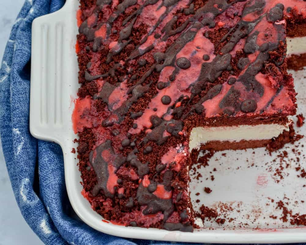 Keto red velvet ice cream cake all the flavor we love about this classic dessert minus all the carbs. It's grain-free, gluten-free, sugar-free and deliciously easy. #ketocake #lowcarbcake #ketoicecreamcake #lowcarbicecreamcake #ketoredvelvetcake #lowcarbredvelvetcake
