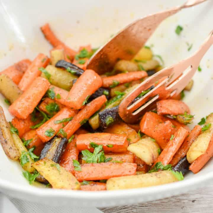 These delicious keto roasted glazed carrots make the perfect side-dish for the holidays. They are much lower in carbs than the traditional glazed carrot dish. #ketocarrotrecipe #ketoglazedcarrots #lowcarbglazedcarrots