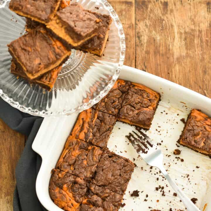 These rich Keto pumpkin cheesecake brownies are perfect for when you have a hankering for both chocolate and pumpkin and can't decide between the two. The fact that they are low in carbs, sugar-free, gluten and grain-free makes them a great treat for anyone doing a ketogenic diet.