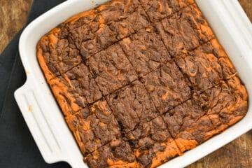 keto pumpkin cheesecake brownies in a white baking dish