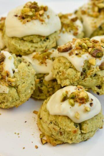 keto pistachio cookies on a white stand