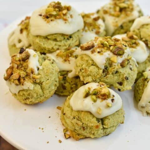 keto pistachio cookies on a white stand