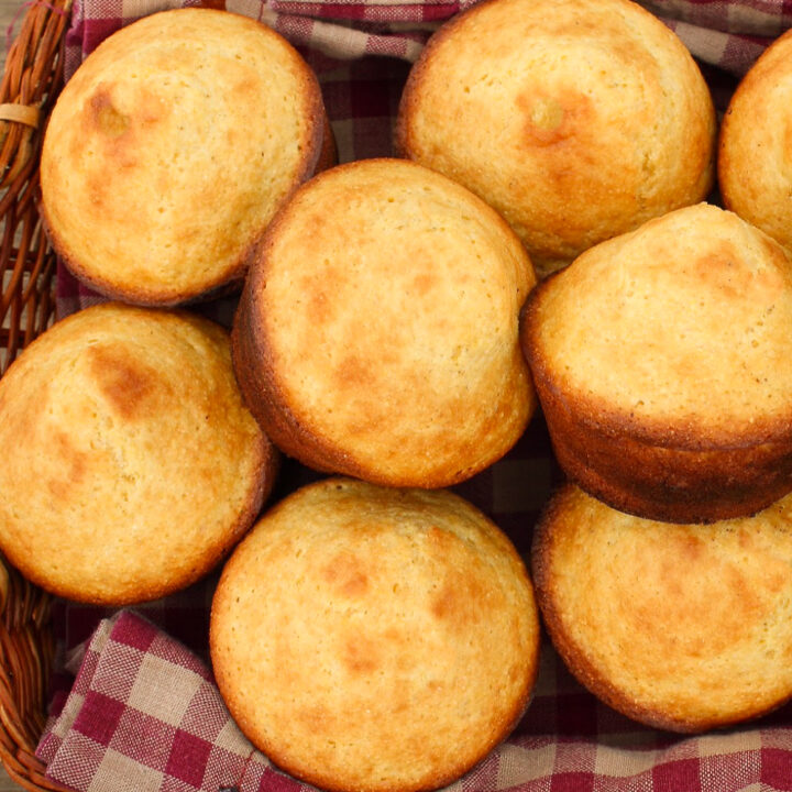 almond flour cornbread muffins in basket with red and white checked napkin
