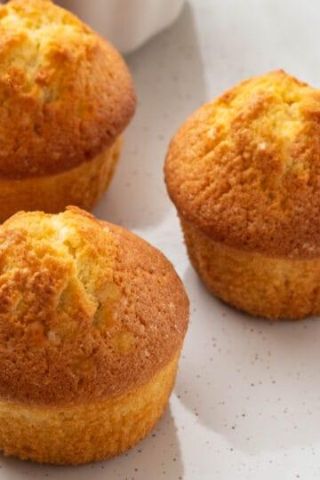 keto coconut flour cornbread muffins on white plate