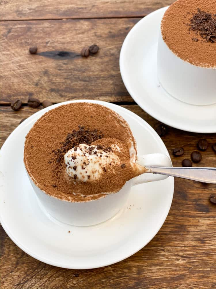 upclose individual keto tiramisu cheesecakes in a coffee cup