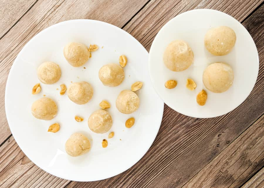Cream Cheese Peanut Butter Fat Bombs on White Plates with Peanuts