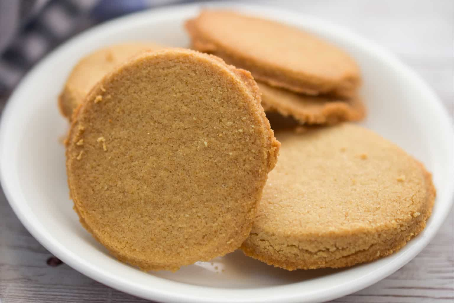 coconut flour shortbread cookies on a white plate