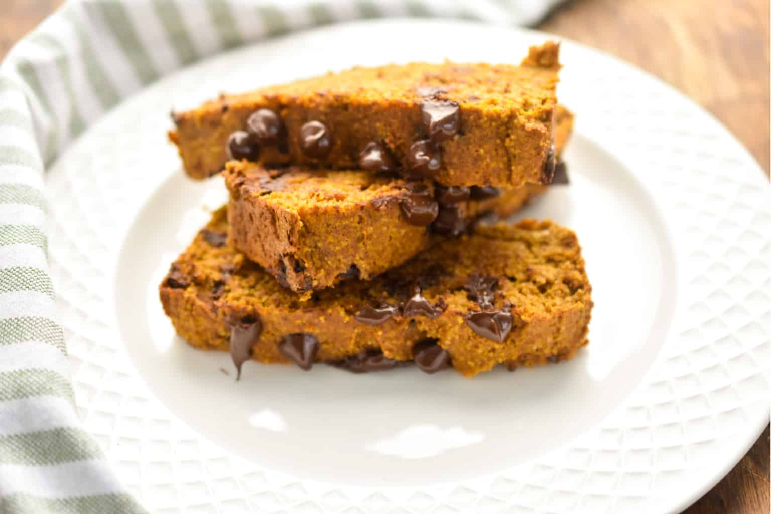 keto pumpkin chocolate chip bread three slices on a white plate