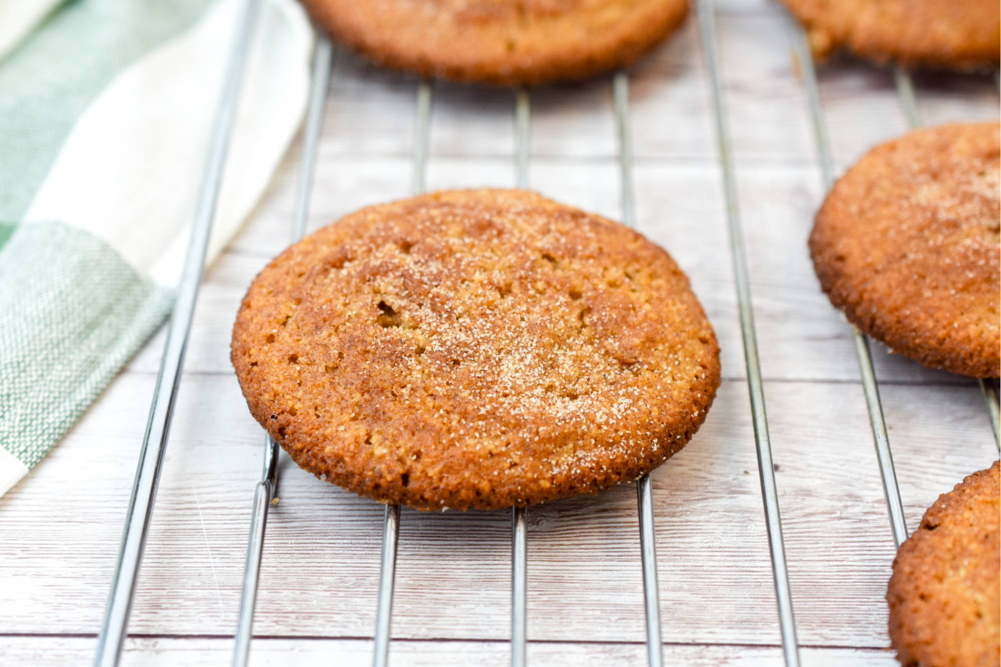 keto snickerdoodle cookies close up on a baking rack