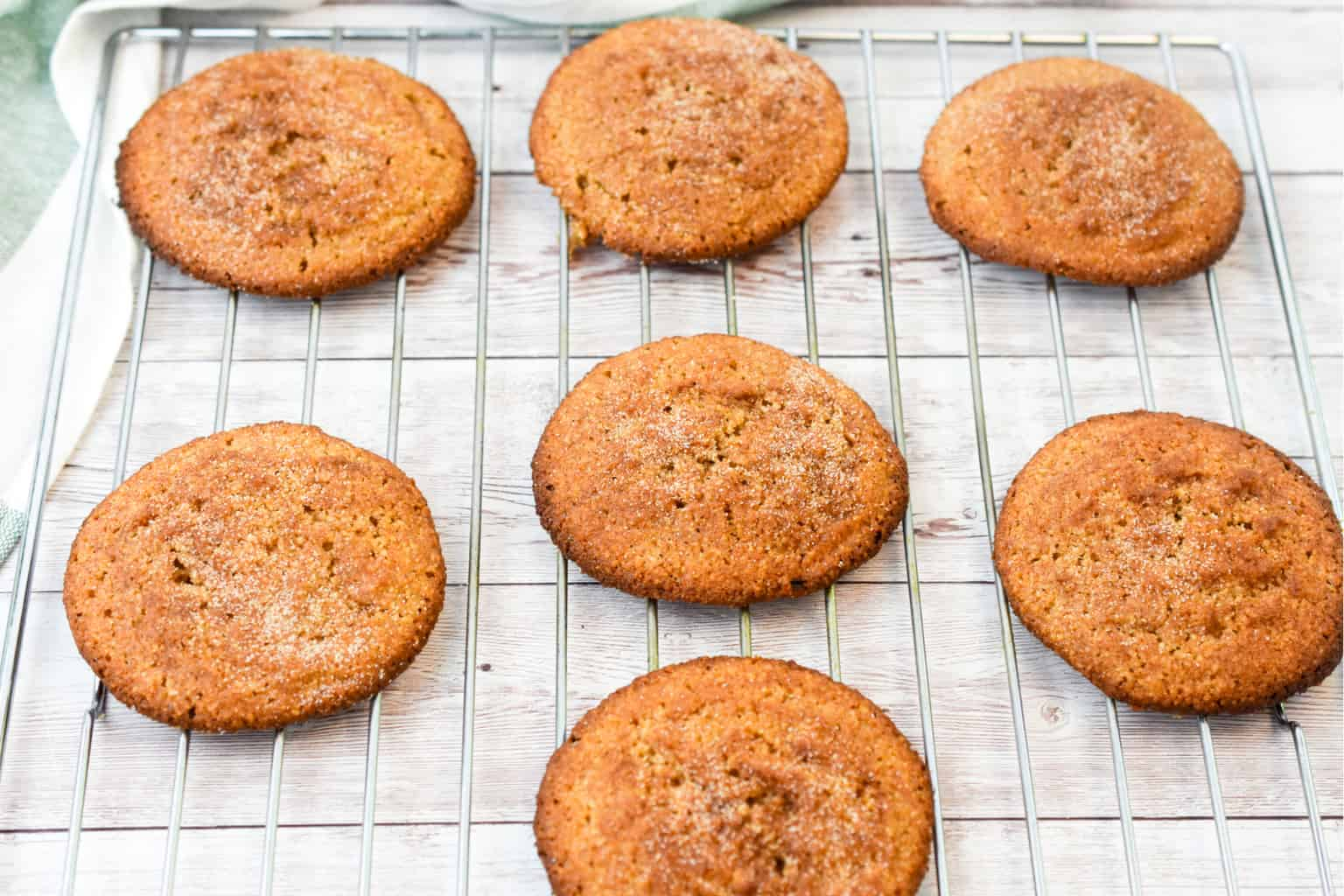 keto snickerdoodle cookies on a baking rack cooling