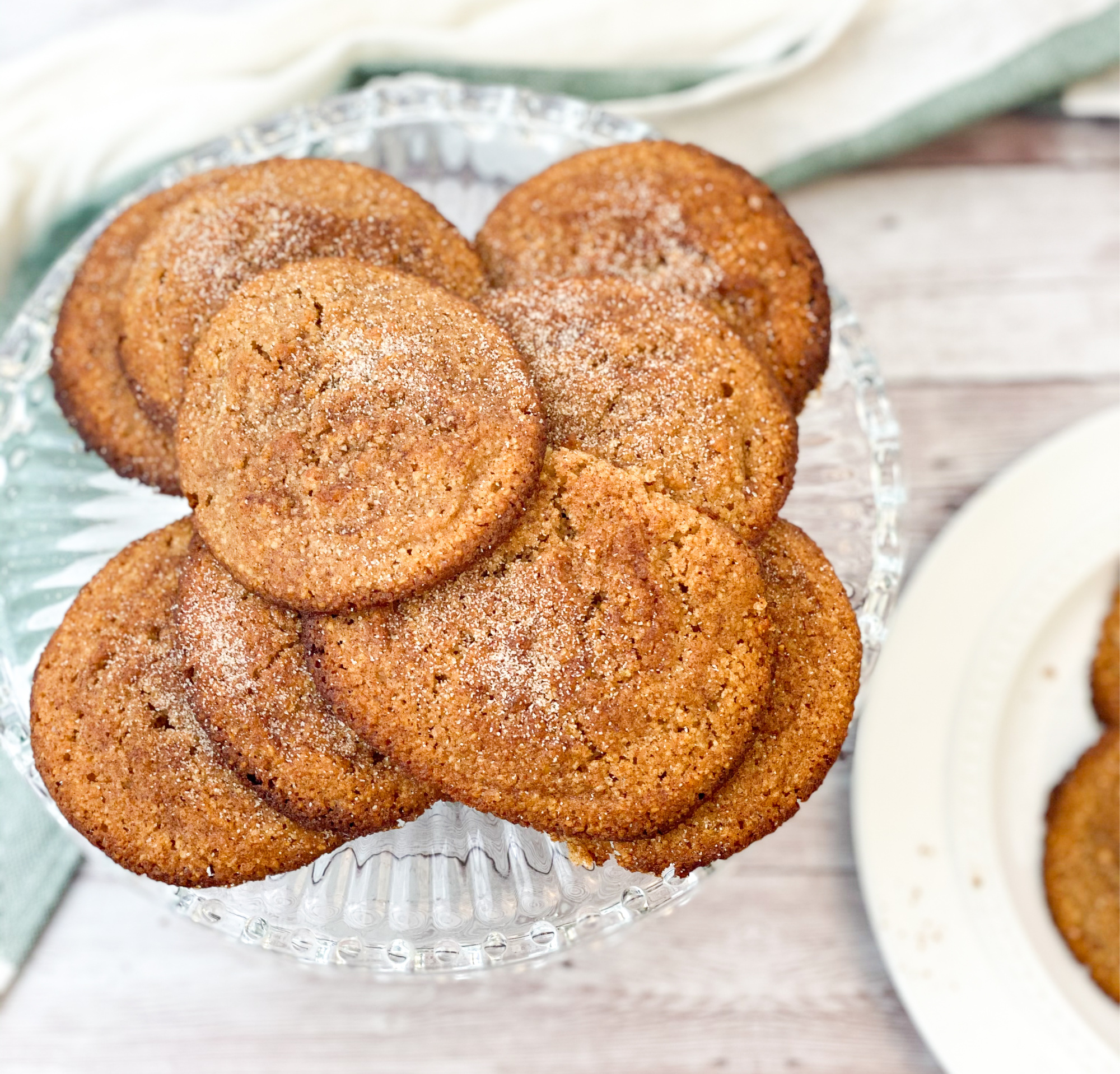 keto snickerdoodle cookies on a clear plate