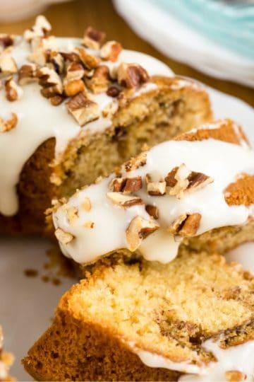 Keto cinnamon cake a bundt cake sliced on a white plate