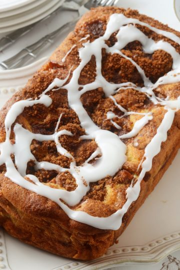 keto cinnamon swirl bread with vanilla icing on table from above
