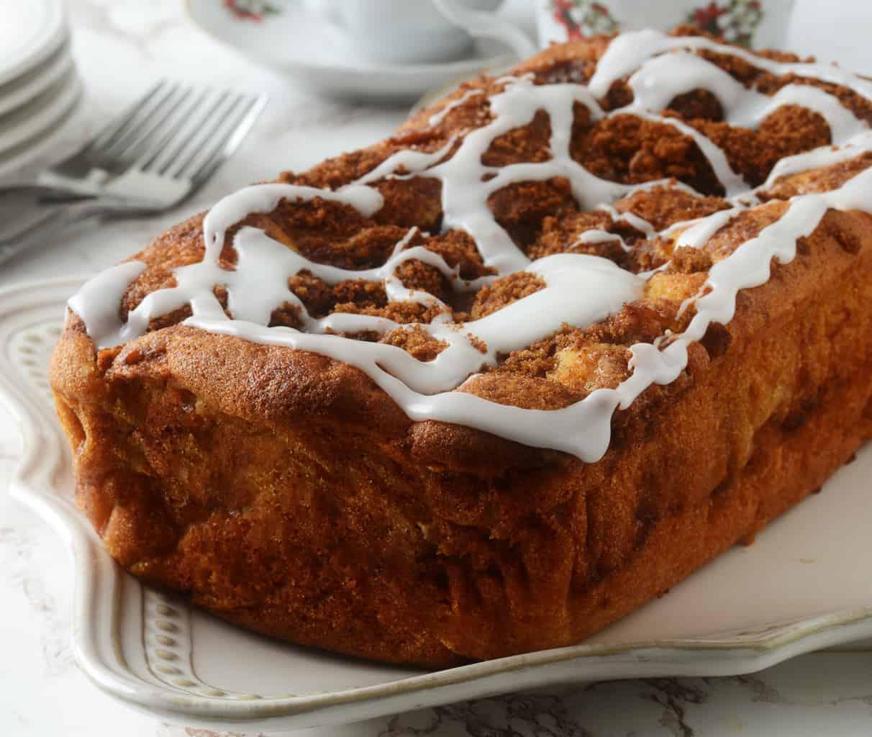 keto cinnamon swirl bread with vanilla icing close up on a white plate
