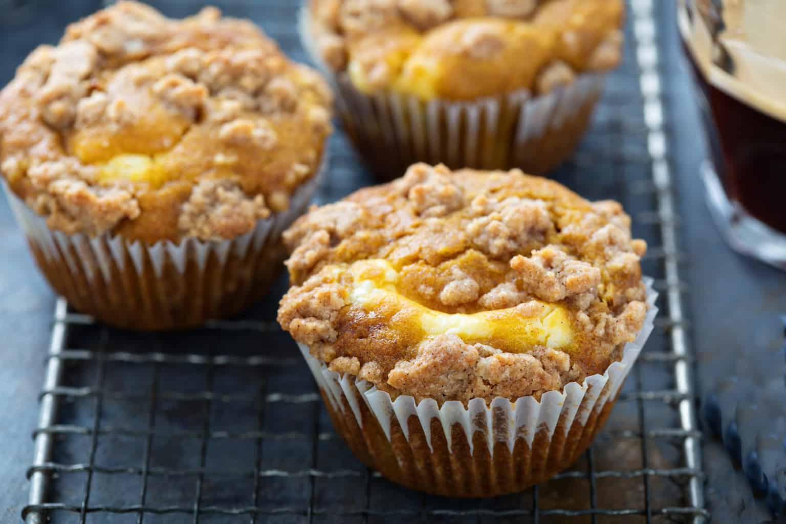 keto pumpkin cheesecake muffins cooling on a baking rack