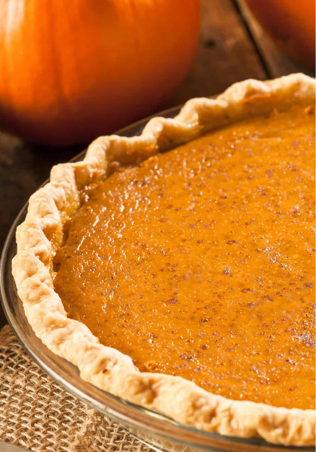 keto pumpkin pie with a pumpkins in the background