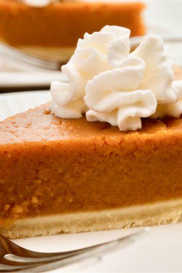 keto pumpkin pie sliced on a white plate