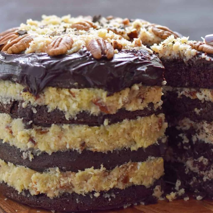Four layer keto German chocolate layer cake being sliced