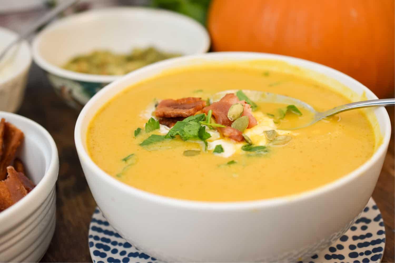 keto pumpkin soup served in a white bowl