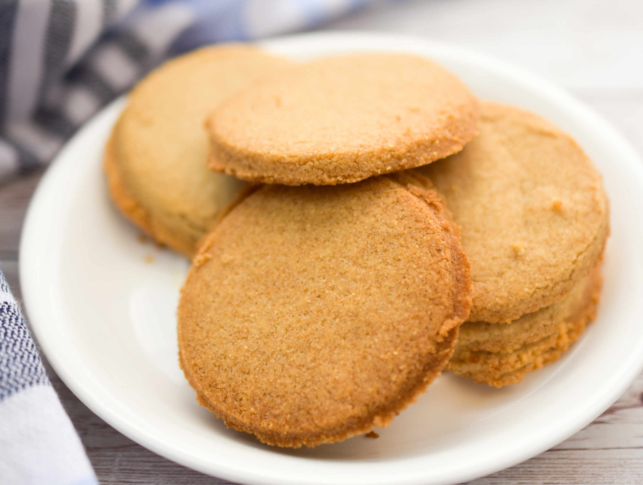 keto coconut flour shortbread cookies on a small white plate