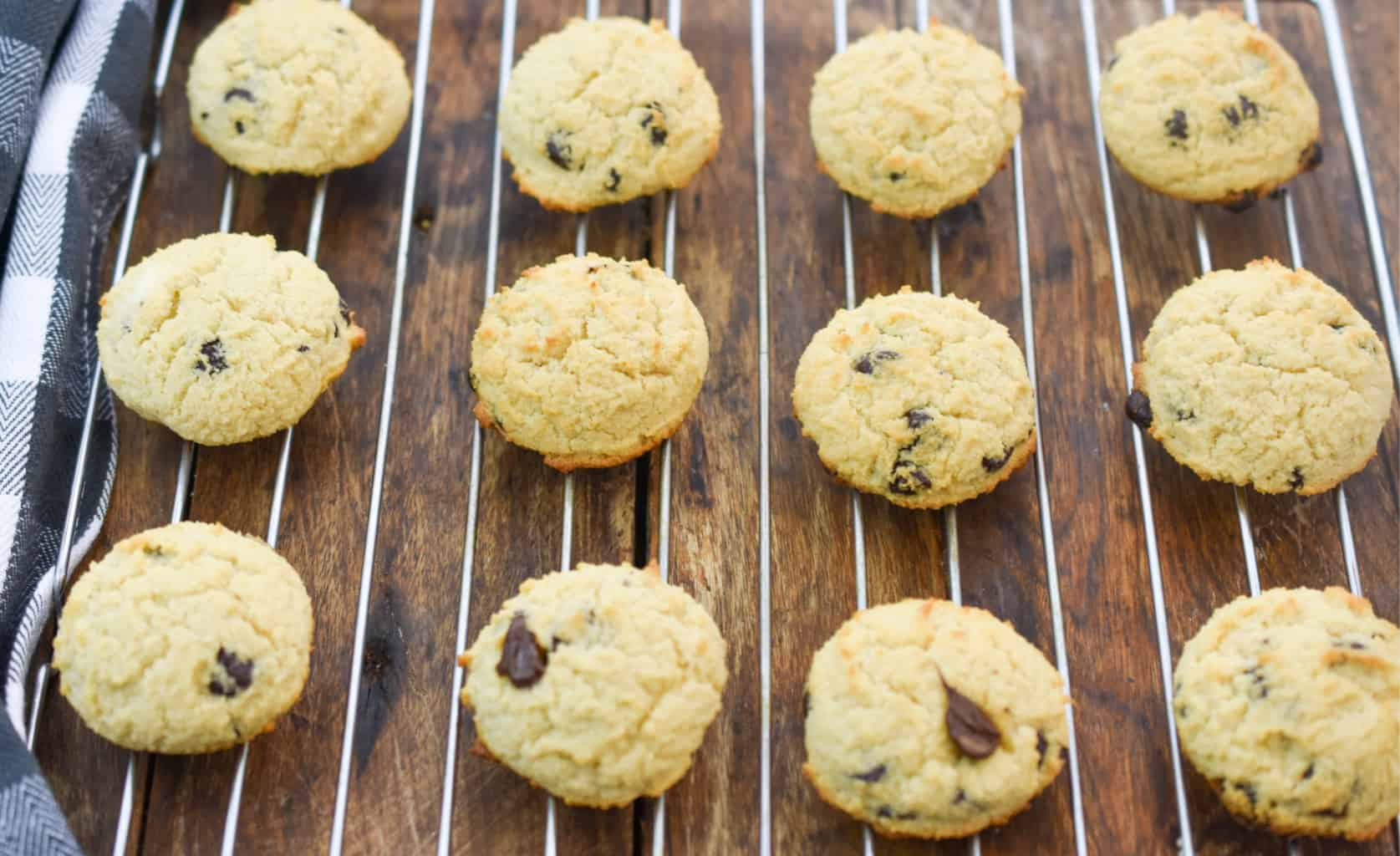 Soft baked keto cream cheese chocolate chip cookies on baking rack cooling