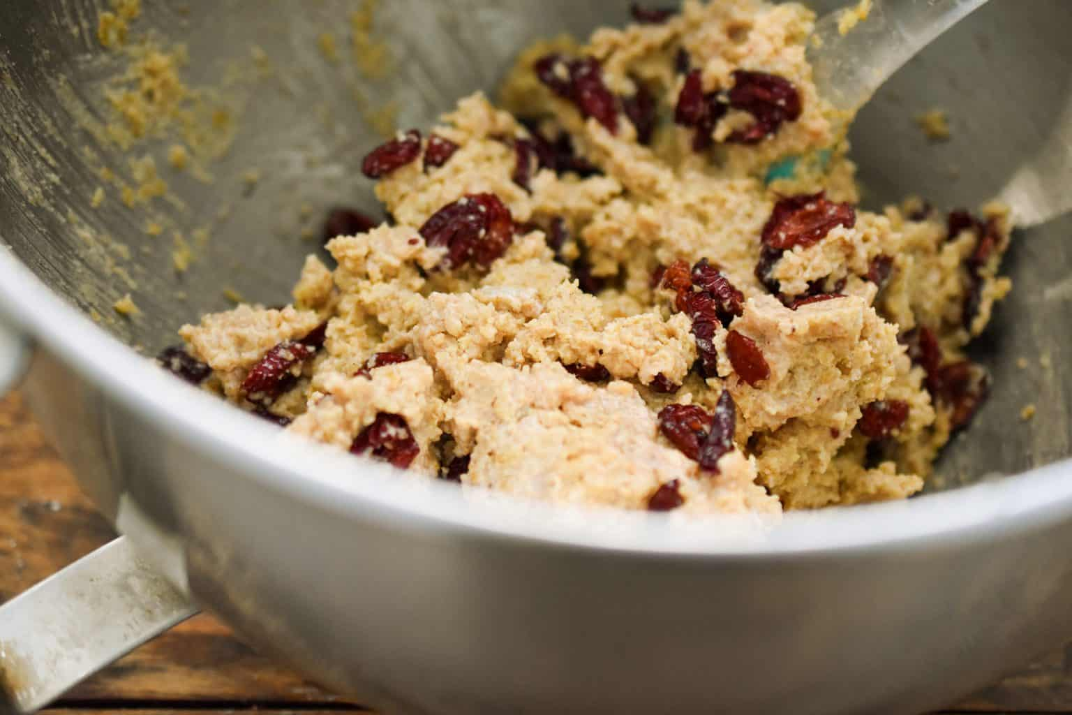 keto oatmeal cranberry cookie dough in a metal mixing bowl