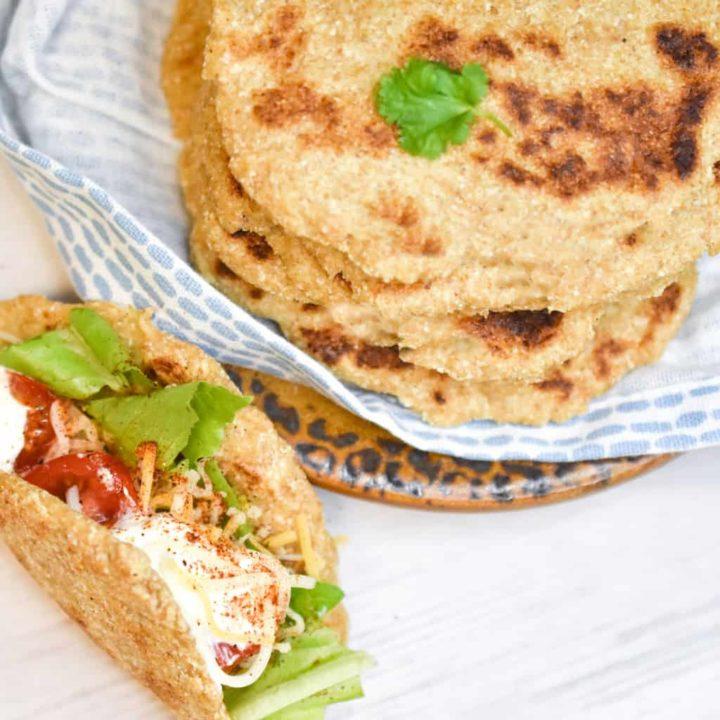 easy keto tortillas stacked on a white a blue cloth napkin