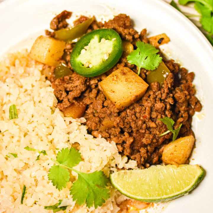 keto Mexican Picadillo served with cauliflower rice on a white plate
