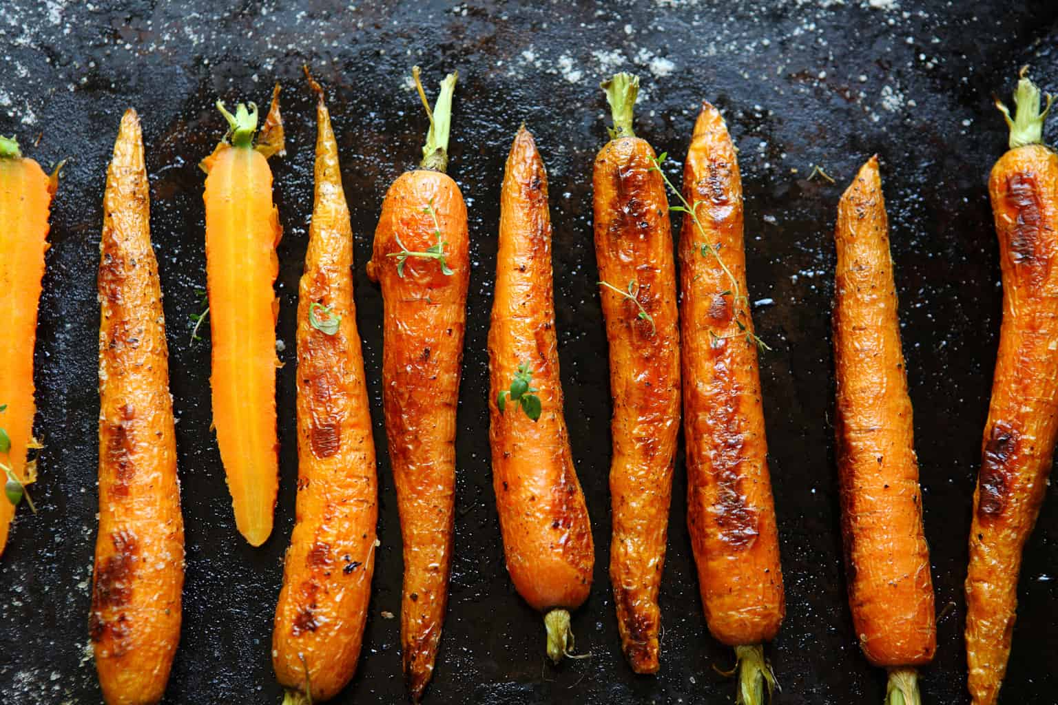 Roasted carrots on a baking sheet
