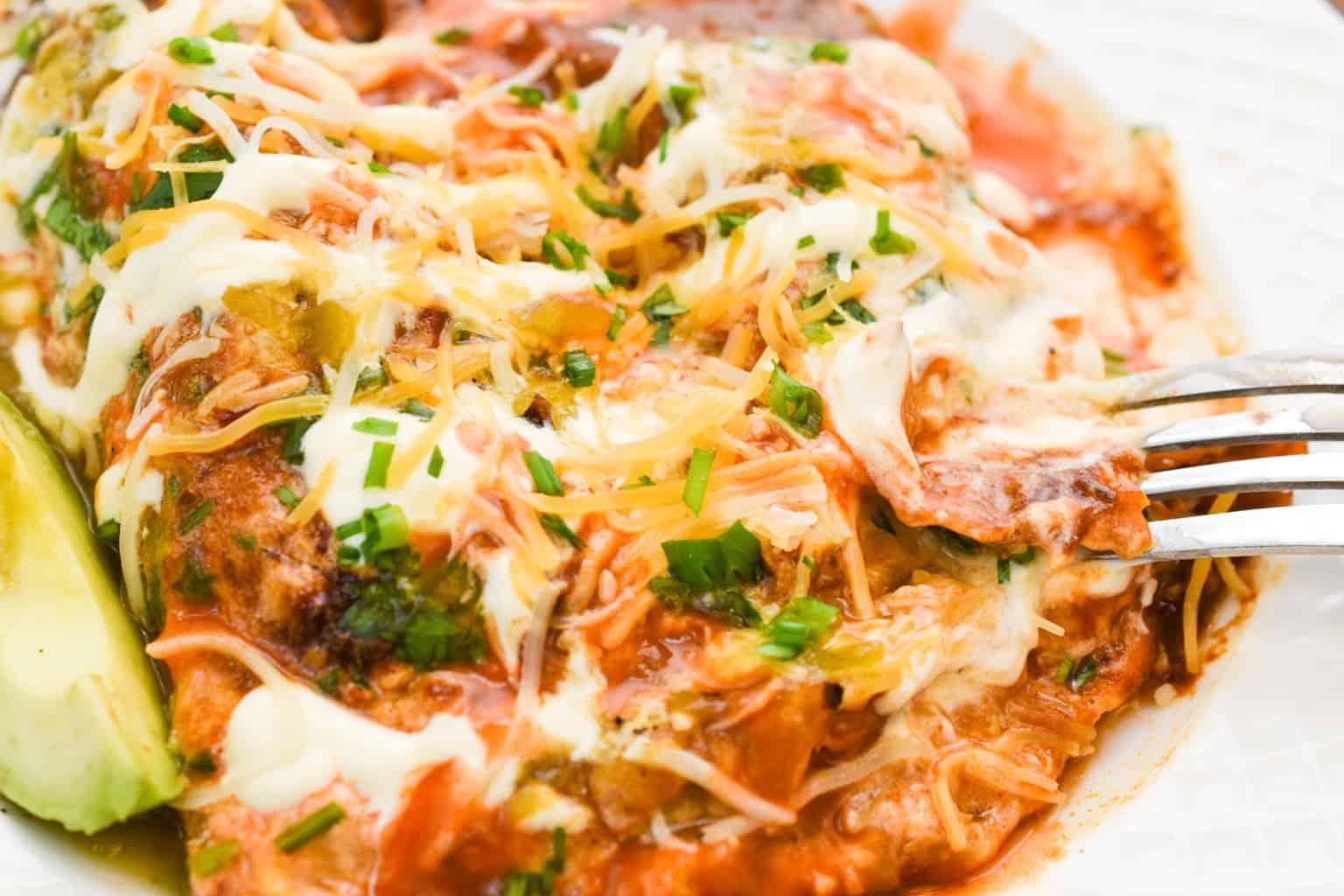 keto chicken enchiladas close up served on a white plate