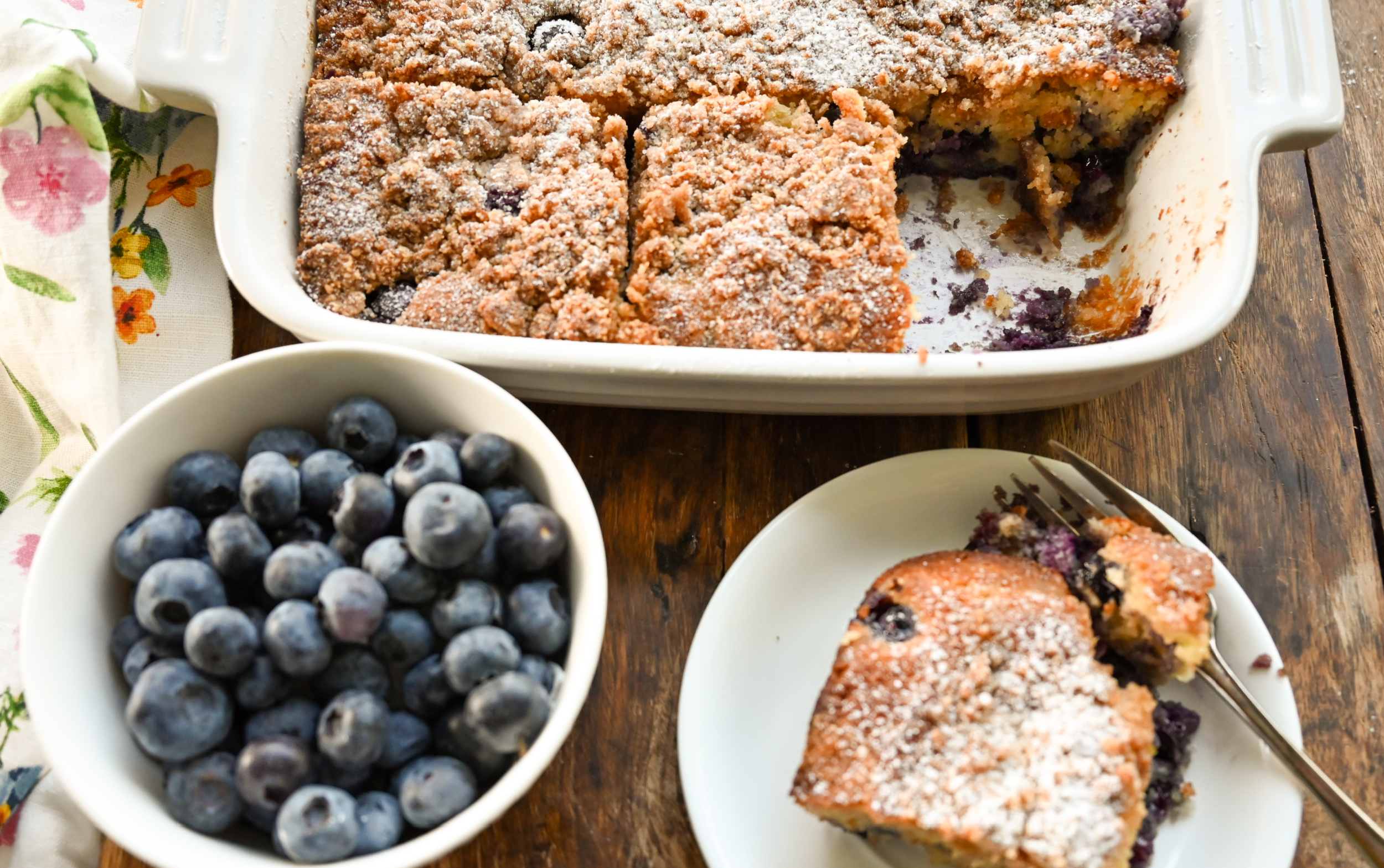 keto blueberry buckle cake sliced and served