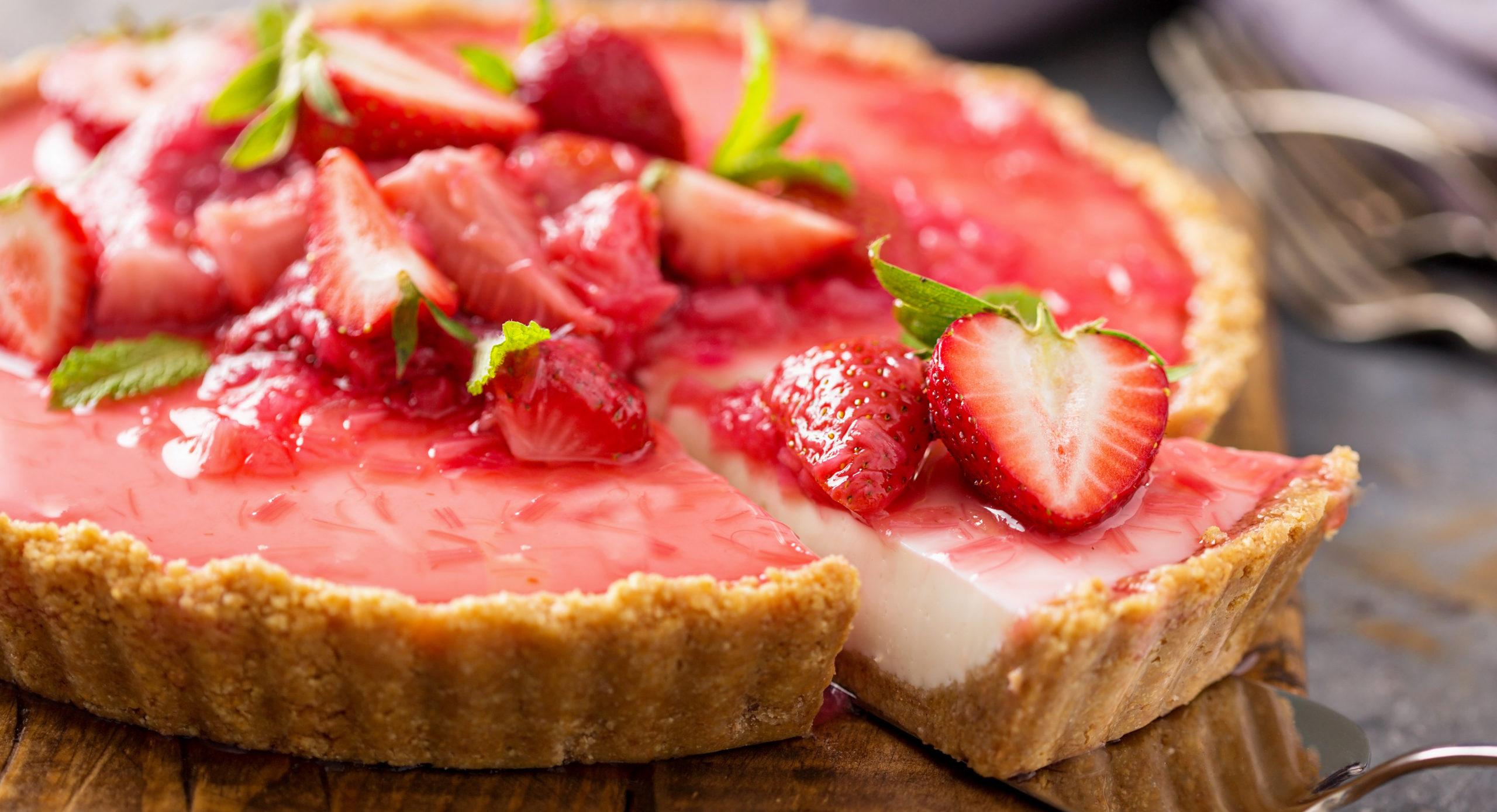 keto strawberry rhubarb cheesecake sliced and ready to serve