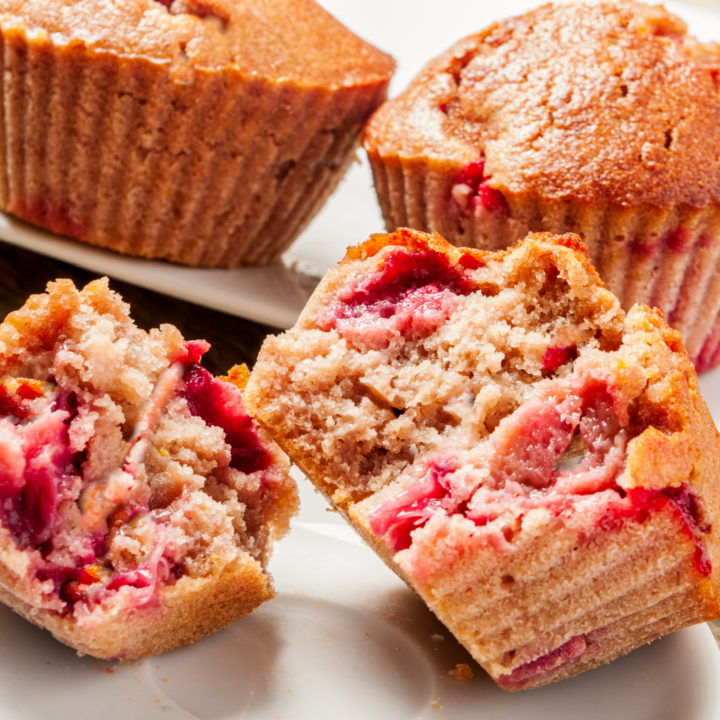 keto strawberry rhubarb muffins displayed on white plates