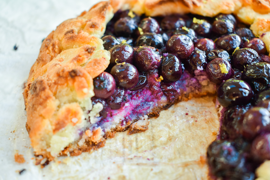 Keto blueberry galette with slice removed and upclose