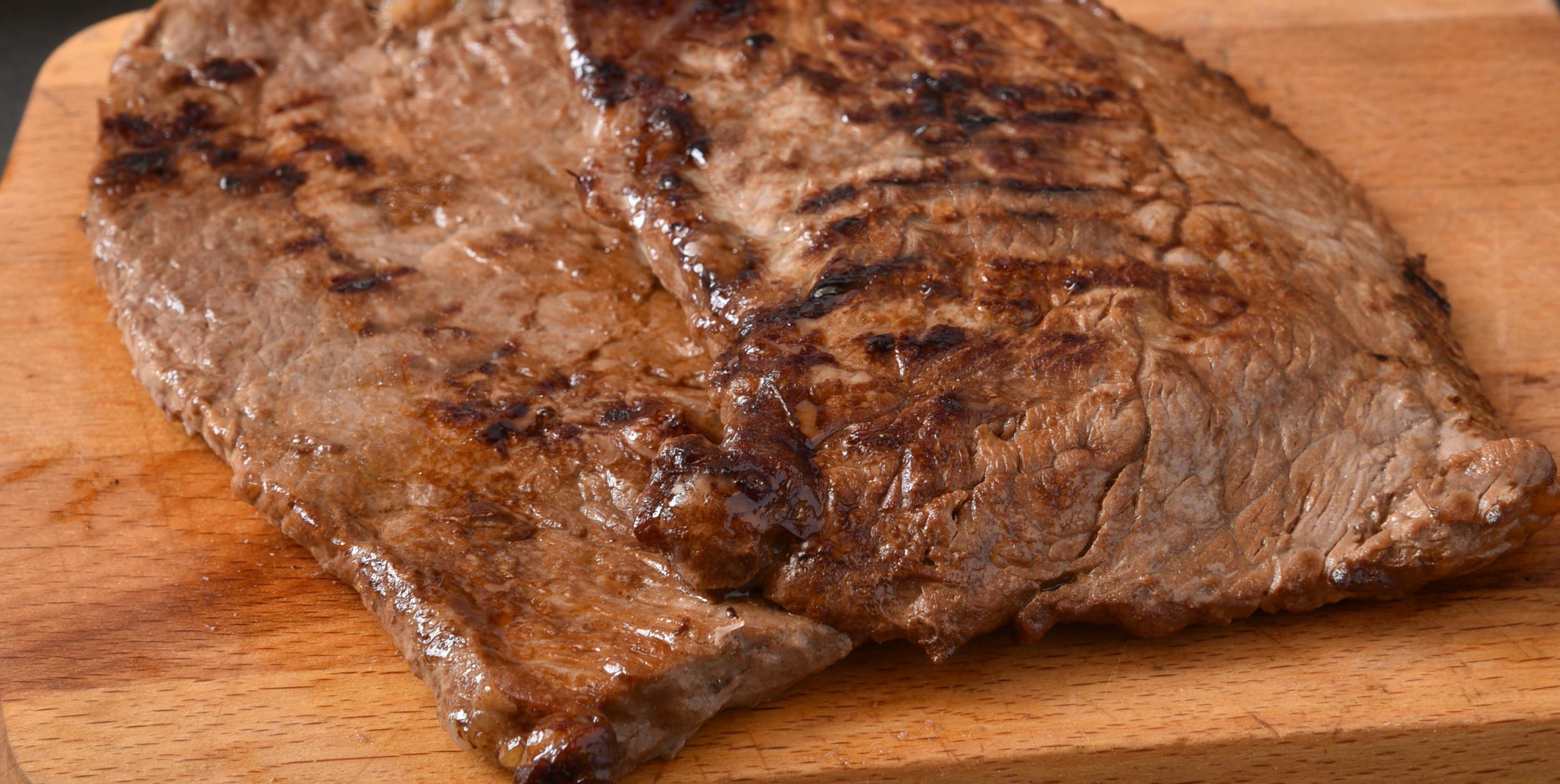 Fresh panfried Cuban steaks on a cutting board